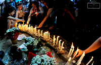 People light candles in tribute to the Paris victims on Sunday, November 15, in Rio de Janeiro, Brazil.