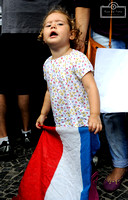 A young girl holds a French flag during a gathering at Largo do Machado, in Rio de Janeiro, on November 15.