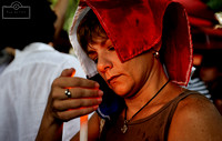 A woman holds a candle during a candlelight vigil at Largo do Machado, in Rio's South Zone.
